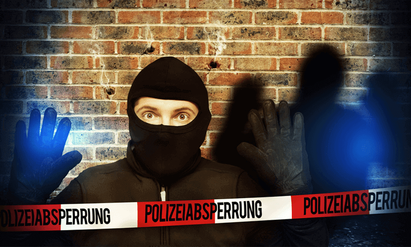 Einbrecher mit Polizeiabsperrung